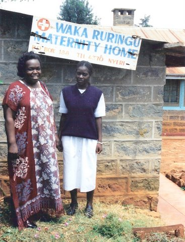 Rosemary with assistant in front of her Clinic